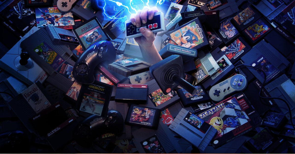 un pugno brandisce un joypad nintendo emergendop da un mare di console, joystick e videogame - nerdface