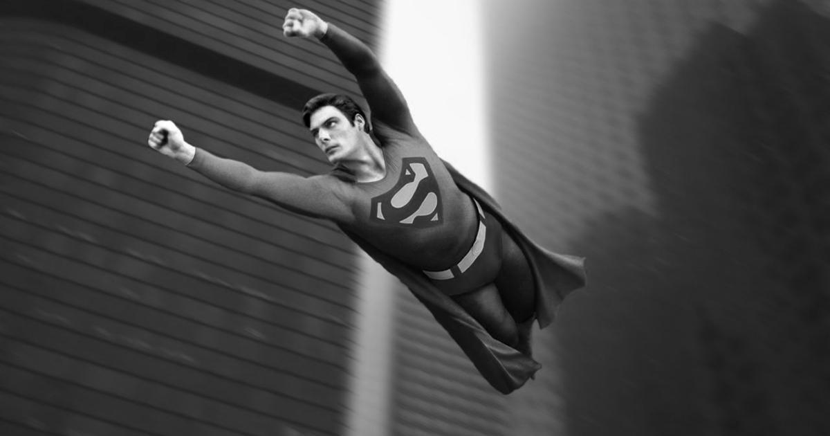 christopher reeve indossa il costume e sfreccia tra i grattacieli come superman - nerdface