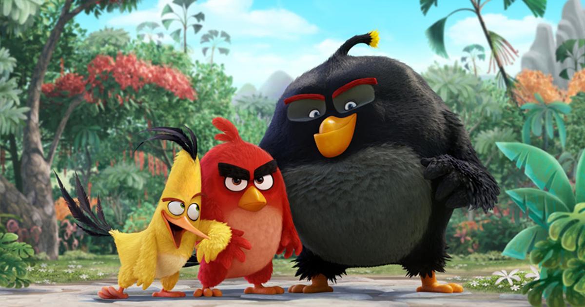 i tre amici uccelli, giallo, rosso e nero, sorridono con malizia - nerdface