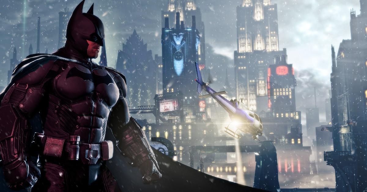 Batman in primo piano con sullo sfondo la città di Gotham illuminata - nerdface