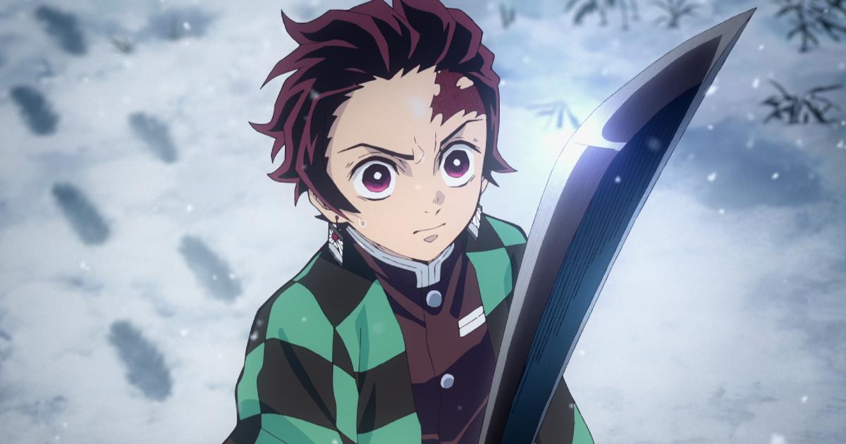 tanjiro impugna la sua spada nera mentre cammina sulla neve fresca - nerdface