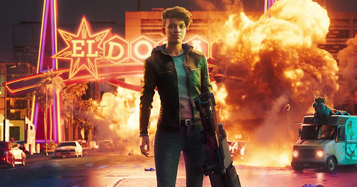 Una donna armata con alle spalle una struttura in fiamme - nerdface