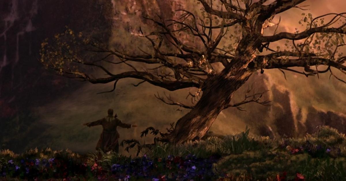 robin williams è di spalle accanto a un albero secco, a bracci a aperte - nerdface
