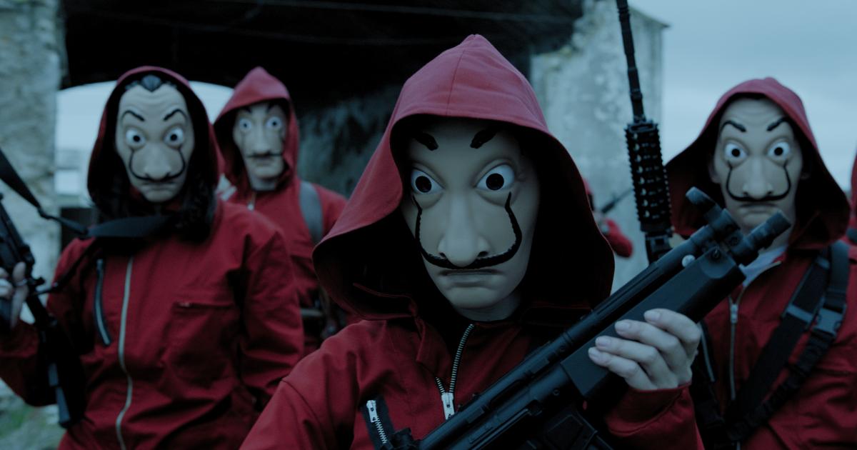 la banda indossa le masxchere celebri di dalì e imbraccia le armi - nerdface